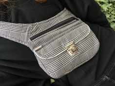 Hip Bag Waist Bag (Fanny Pack) HandBag & Bandolier model design Elegant Silver High quality YKK zipper color Black. Click-Clack fastener color Silver. Lined inside. Tape adjustable fit in black with black 4cm closure. Maximum subjecion and comfort. Two large capacity pockets. Sizes: Height: 22 cm (8,5 inch) Width: 25 cm (9,9 inch) Length: 5 cm (2 inch) Strap length: 80cm (31 inch) a 100cm (39 inch) - Exclusive Piece Number 1266 - What make CAOMKAs product especial? - Handmade of high...