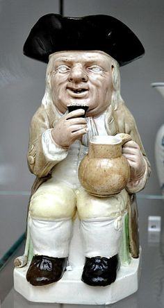 This is an antique 'Toby Jug', made by Ralph Wood (the Younger), Burslem, c.1782-1795; lead-glazed earthenware
