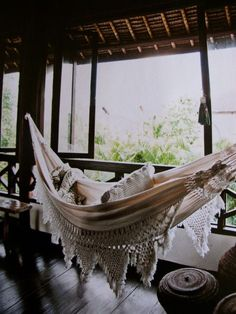 Boho hammock perfectly positioned to catch the afternoon breeze. Lovely.