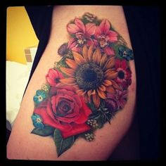 Sunflower tattoo and other beautiful flowers - These tattoos have a very beautiful mix of colors. It is so alluring. #TattooModels #tattoo