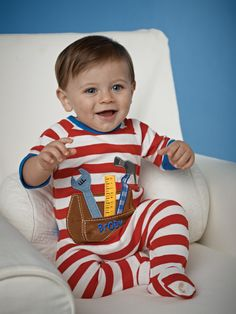 Your baby boy will love sleeping in this long sleeve, woven footed sleeper from Mud Pie. This handsome sleeper features a suede toolbox applique so he can dream of growing up to be just like dad!    Sizes Available: 0 - 6 months. Free Embroidery  www.mjspiritwear.com