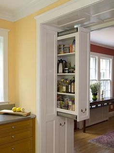 Wide casement between rooms with no plumbing or electrical? Perfect spot for slide out pantry doors