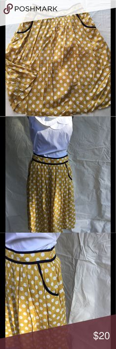 Retro Polka Dot Skirt with Pockets Retro style mustard and white polka dots with navy blue piping.  Pockets are functional.  Fit is very forgiving since it's a swing skirt. Anthropologie Skirts Midi