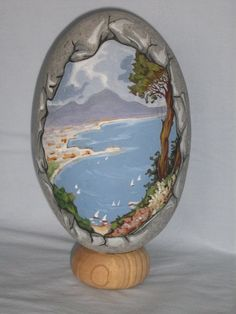 Love this rock framed scenery painted on stone!!