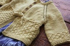Lovely little sweater, pattern available on Ravelry