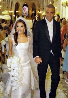 Eva Longoria wore a silk georgette and organza gown by Angel Sanchez with ribbons of gazar metallic embroidery and a five-foot train. Her bouquet consisted of white phalaenopsis orchid stems and crystal blush calla lilies. She had nine bridesmaids, each wearing a red Badley Mischka gown embellished with Swarovski crystals. Tony wore a suit provided by French designer De Fursac.