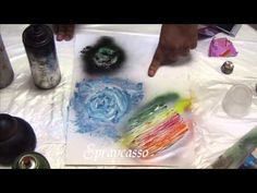 Video tut on creating art w/spray paint - cool techniques which may work w/scrappers mists and such.