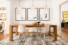 Gorgeous loloi rug with eiffel dining chair in this modern dining room