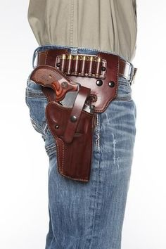 Paired perfectly with our Alaskan Hunter Holster, the Alaska Hunter Drop Loop accessory adds not only the ability to carry your holster lower on your hip, bu. Cowboy Holsters, Western Holsters, Custom Leather Holsters, Pistol Holster, Phone Holster, Leather Projects, Leather Crafts, Leather Tooling, Firearms
