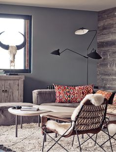 Modern Southwest: love the reclaimed wood feature wall.. Our Lapi Hide would make a perfect addition!