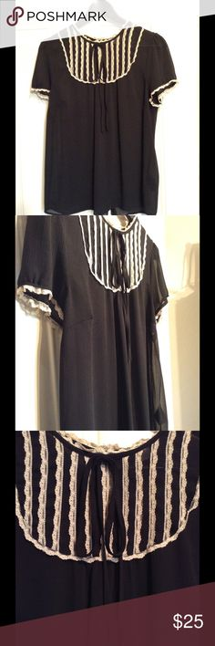 Divided by H&M, Black Sheer Blouse w/ White Lace Black Sheer Blouse with white lace accents, and trim. Buttons up back. Divided by H&M. Good condition. Divided Tops Blouses
