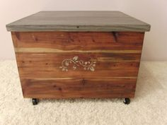1957 Lane Cedar Chest / Trunk. Originally an old large coffee table, covered in veneer, handscraped to reveal beautiful cedar hiding beneath. refinished and casters added to coffee table. Top finished with washes of gray, black and white.