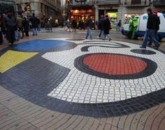 This tiling can be seen on the infamous La Rambla here in Barcelona. The mosaic was created by Joan Miró. The tile design here reminds me of the circular, colorful, grandiose tiling done on the ceiling of the Hypostyle Room.