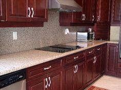 Silestone with Dark Cherry Cabinets.  Kitchen.