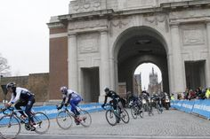 The peloton passes through the Menin Gate in Ypres