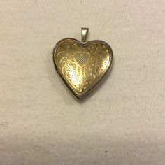 """Vintage Sterling Silver 14Kt gold heart Lockett Marked PPC WHICH MEANS Princess Pride Creations jewelry..Heart Locket..Sterling Silver w/14Kt Gold lace on the front of locket..measures 1"""" x 1"""".. Excellent condition PPC Jewelry"""