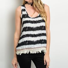 Black and ivory tie dye top with fringe at bottom and orange detailing. Polyester. 24 inches long. Made in USA