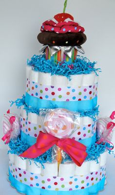 Diaper Cake - The Ultimate Sweet Treat Cupcakes & Candy Baby Girl  Diaper Cake Centerpiece- 3 Tier - Shower Decoration and Gift. $85.00, via Etsy.