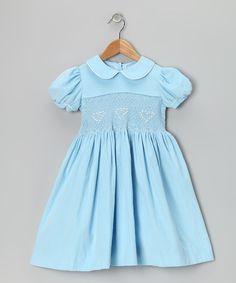 Polished yet playful, this darling dress is ideal for a special occasion—or for turning an otherwise ordinary day into a special occasion. The heart-embellished smocking puts an extra-girly twist on a classic silhouette.100% cottonMachine wash; tumble dryMade in Colombia