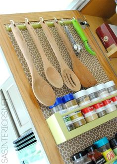 14 Space-Saving Hacks To Maximize Your Small Kitchen--I wonder if something like this could be done in the trailer cupboards