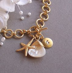 Beachy bracelet with a starfish, mother of pearl, and brass disk charm
