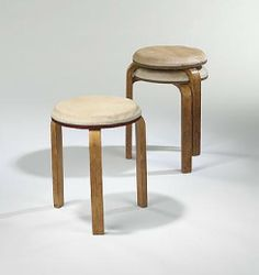 Alvar Aalto 					L-leg stools, set of three   					 						Finmar Finland , 1933 birch, muslin over horsehair