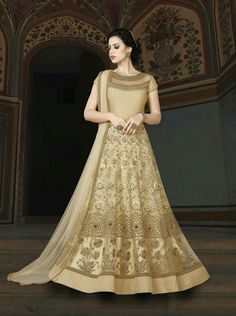 Enhance your ethnic charm by wearing this fashionable beige color premium net embroidered party wear anarkali salwar kameez. Its unique design and beautiful color will fetch a lot of second glances as you club it with contrast colored flashy accessory. Long Anarkali Gown, Bridal Anarkali Suits, Anarkali Frock, Floor Length Anarkali, Cotton Anarkali, Floor Length Gown, Lehenga, Sarees, Punjabi Fashion