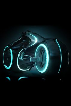 Tron Legacy is due to come out in picking up the story from the original Tron. The sequel will continue the story as if 20 years have gone by, with the Tron server sitting in isolation, honing its game. Of course one of the best parts about the new Tron, Tron Legacy, Cyberpunk, Tron: O Legado, Maquillage Phosphorescent, Tron Light Cycle, Tron Bike, Futuristic Motorcycle, Retro Motorcycle, Motorcycle Design
