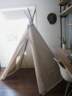 Canvas Teepee from houseinhabit on Etsy. Reminds me of my childhood. I spent many happy hours drawing pictures, reading books and daydreaming in my backyard teepee.