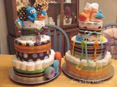 Make a Diaper Cake for Baby Shower - Spoons, toys, diapers, socks, etc.
