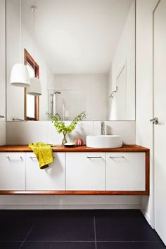 modern small space bathroom with wood finishes