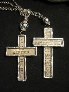 Soldered glass crosses with pieces of pages from a torn and tattered 1862 Bible.