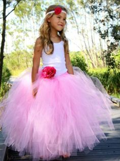 Pink girls Multiway skirt teamed with vest top . Ideal for any party celebration .at www.little-n-pinkboutique .co.uk