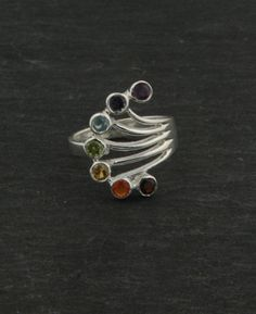 Chakra ring with seven gemstones for the seven chakras – to awaken ancient energy centers. Made of sterling silver in India. Chakra jewelry available at BuddhaGroove.com.