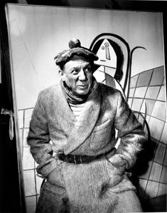 """Picasso In Paris Studio, 1944 . """"Tete de Femme"""" in background. 