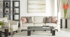 """This living room table is attractive, modern and in fashion with its unique base design. These tables are characterized by a 3/4"""" thick cracked glass top, dark, chunky, rectangular legs and shiny metal accent pieces. This contemporary piece has as much durability as it does design."""