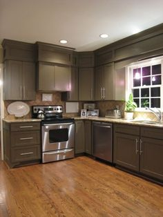 kitchen colors. ceiling crown and trim on on wall above cabinets