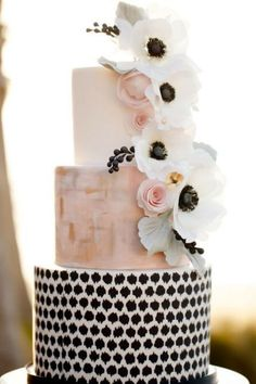 unique wedding cake with ivory, blush and black tiers and flowers