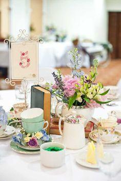 vintage tea themed wedding table centerpieces via wedding ideas magazine