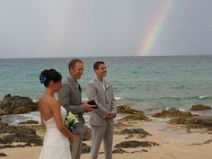 Jessica and Max marry under a rainbow.