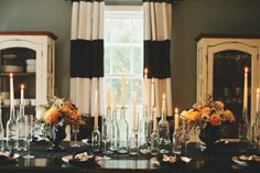 an elegant Halloween Dinner Party tablescape  Photography by rebeccahansenweddings.com, Floral Design by foret-design.com, Design   Styling by stylemepretty.com