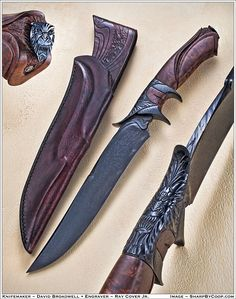 Blued mosaic damascus blade, clero walnut handle and blued fittings with Ray Cover's carved Gargoyles. Sheath is layered cow hide and overlaid in calf skin.