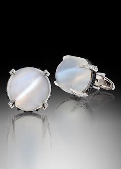 Killer Cufflinks - Adam Neeley Fine Art Jewelry. Mysterious and Sophisticated. Killer cufflinks showcase two dazzling cat's eye moonstones, totaling 25.60 carats, accented with 1.90 carats of black diamonds and .70 carats of white diamonds in 14 karat white gold.
