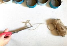 A mom rinses a leftover tuna can. What it becomes? I am so doing this in my daughter's bedroom!