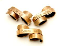 This just purchased: The Original Custom Double Banner Ring (also available in 24k gold, market price). Brass $40.00, via Etsy.