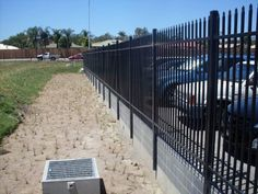 Steel Security Bolted to Retainer Wall Crimped Spear Top Security Fencing, Sidewalk, Steel, Fences, Building, Outdoor Decor, Wall, Home Decor, Home Ideas