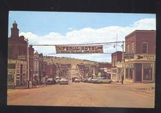 1950's CARS CRIPPLE CREEK COLORADO DOWNTOWN STREET SCENE VINTAGE POSTCARD COLO.