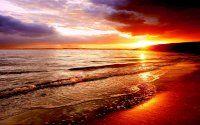 Sahil dalgalar gün batımı manzara