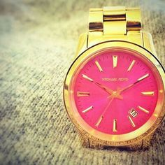 Love the pink face on this glamorous watch!
