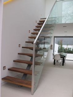 Rhoco, Centre spine staircase with Iroko treads, structural glass and stainless steel handrail.